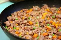 hamburger carrots onion in pan